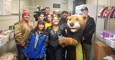Students and mascot in food pantry